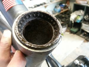 Sweat corroded head tube bearings.